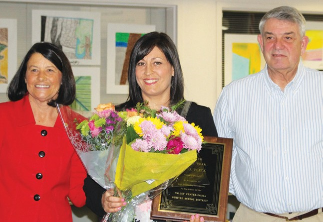 School Supt. Mary Gorsuch (left), Teacher of the Year Satya Fleck and School Board Pres. Don Martin.