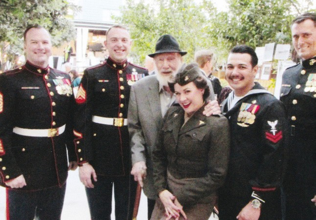 Hank Weldon with some current-day American heroes and a member of the Satin Dolz singing group.