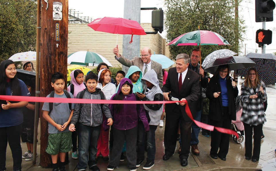 A rainy ribbon-cutting celebrated another goal achieved in making Escondido's streets safer for kids walking back and forth to school.