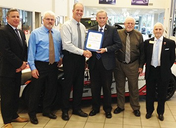 Scott Whitehead is presented Assemblymember Marie Waldron's January Business of the Month award by Tom Stinson, District Communications Director. Also pictured, left to right: Damien Campos, Tom Belt, Bob Lustig and Don Burgett.