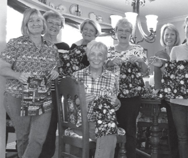 "The women of the Valley Center Optimist Club are pictured showing off the ""Treasure Bags"" they make for the children of Rady Children's Hospital. The children are given a bag upon admission to hold their ""treasures"" while they are patients at the hospital, and take home upon discharge. The Optimists provide material, notions, and sewing expertise for this charitable project. Left to right are Jane Fox, Dottie Rayhawk, Bobbie Paulson, Lyn Renouard, Nina Aguilera, Flo Walmsley and Chelsea Trimble."