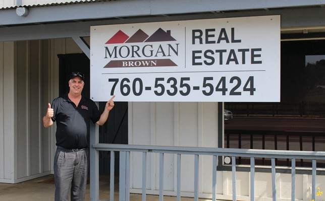 Morgan Brown, who used to be a familiar face around Valley Center a few years ago, is returning to the town where he lived for many years, and plans to sell real estate here. Brown is one of the most successful agents in North County, and is also, as you can see, a snappy dresser. He invites his friends to give him a call. He is shown at 27525 Valley Center Rd.
