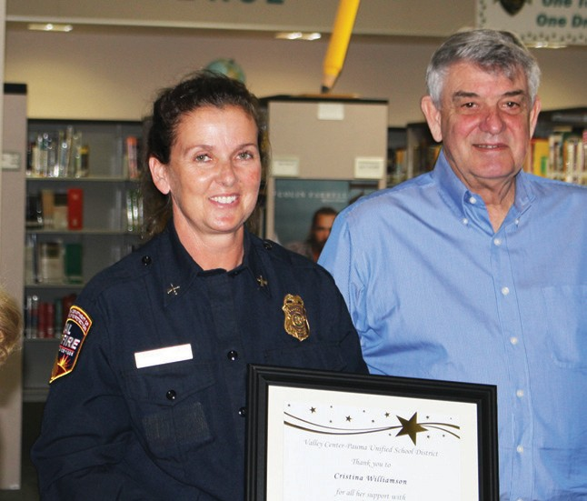 The VCPUSD board recognized Cal Fire Battalion Chief Cristina Williamson for all her support of student safety. Williamson is shown with school board Pres. Don Martin.