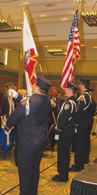 The color guard combined the fire and police departments.