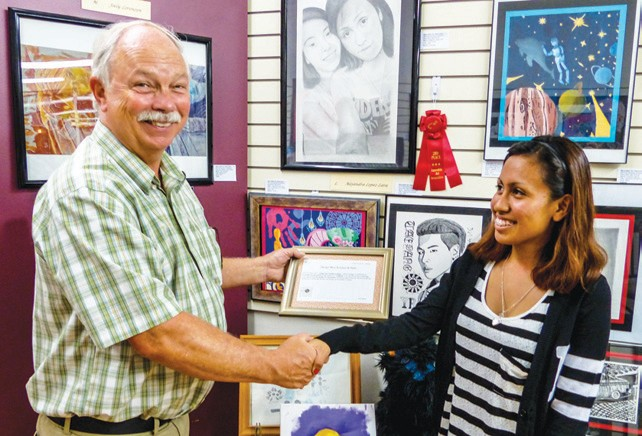 Alejandra Lopez Lara collects her second place award from EAA President Byron Marler.