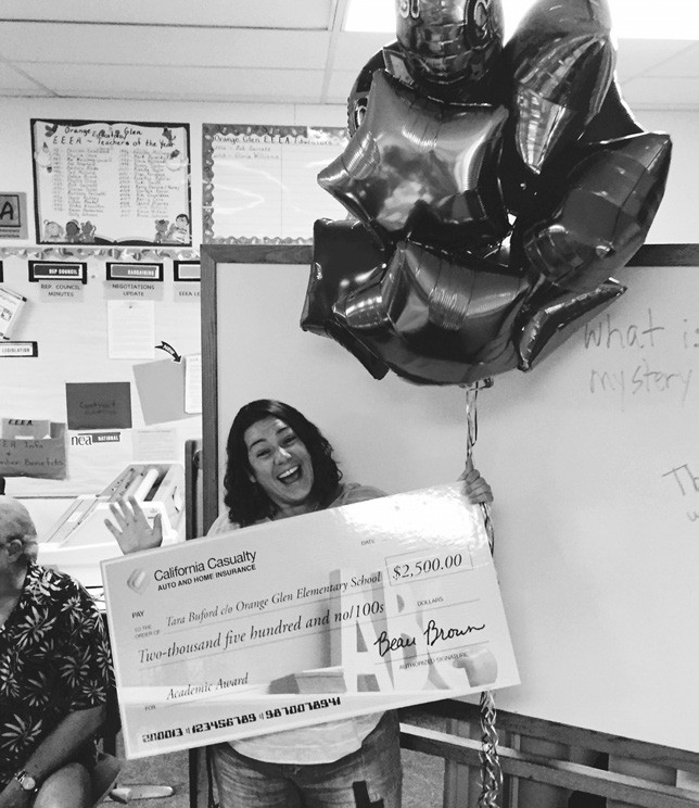 SURPRISE!—Tara Buford holds the check for $2,500 that she found waiting for her on April 23.