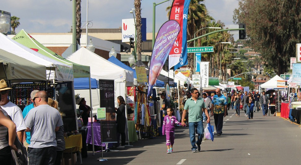 The street scene on Grand Avenue as the festival heated up on Sunday.