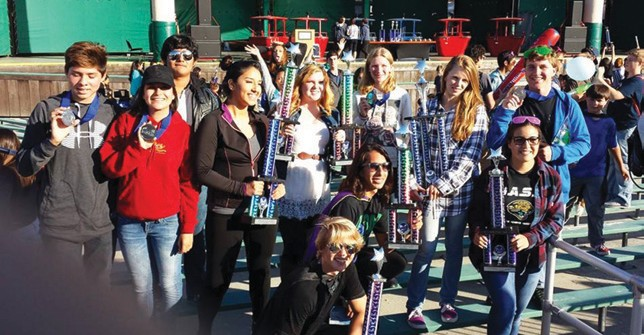 High school and middle school band students celebrate their ever growing collection of competition awards last week.