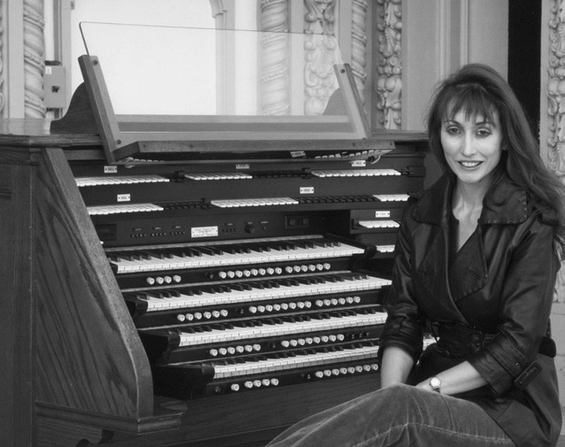 Carol Williams and the Balboa park organ where she plans to set a world's record for playing.