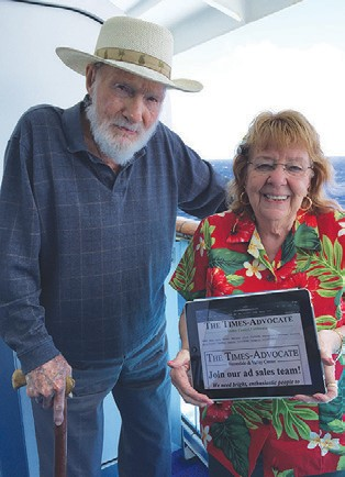 Some people like to go on vacation and take pictures of themselves with their hometown newspaper. But this is the 21st century, after all, so Hank & Donna Weldon decided to call up the picture of their hometown paper on their digital platform for the picture during their recent two week cruise to Hawaii.