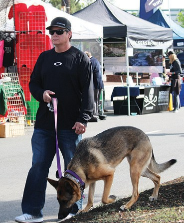 "Escondido held it's twce yearly Grand Avenue Festival on Sunday. One of the most fun things about the event is the chance to ""dog watch."" It's a great day for the pooches and you'll see hundreds of dogs during the course of the day."