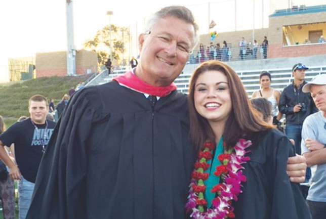 Coach Rob Gilster congratulates graduate Jessalyn Giglio at Thursday's VCHS graduation.