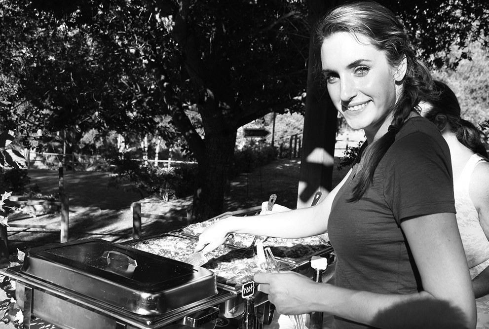 Jeana Boulos gets ready to serve vegetarian and meat lasagna at the Sundowner.
