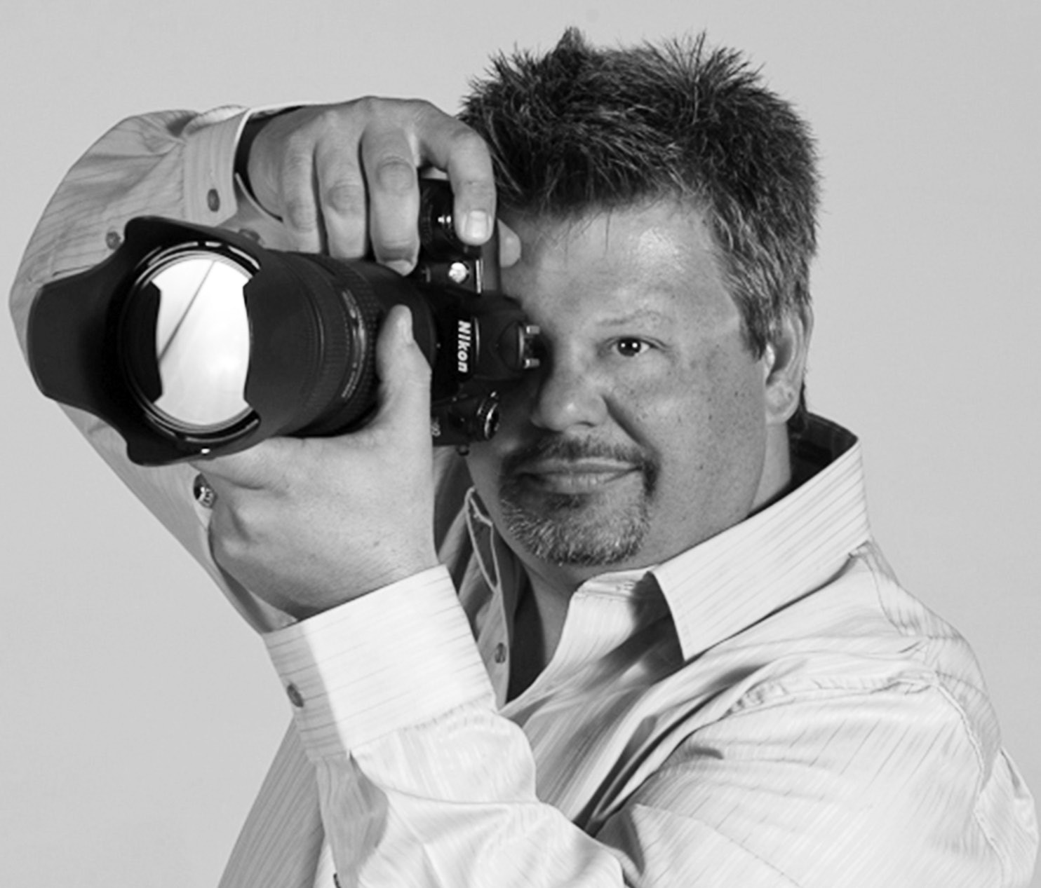 Photographer Richard Schultz with camera.