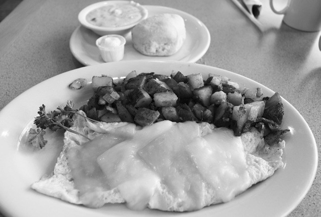 Hearty fare: The cheese omelet, home fries with a side of biscuit and gravy.