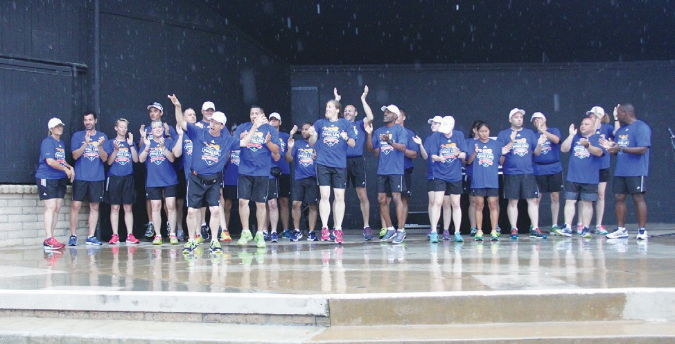 "A wet Saturday did nothing to dampen the spirits of the Special Olympics ""Flame of Hope"" on July 18. Photos courtesy of the Special Ilnmpics. Photos by Andrea Kramer. See more photos Page 12."