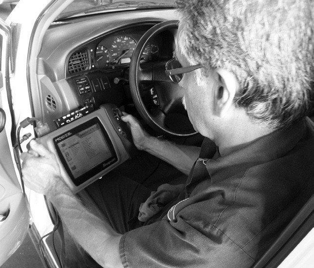 Robert Mirales scans a vehicle for trouble codes. Check engine lights store these codes.