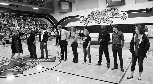 Principal Ron McCowan (left) introduces new teachers at the high school during the first day pep rally.