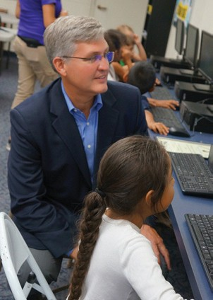A girl playing a math game shows Supervisor Dave Roberts her skills at the Mitchell Boys & Girls Club in Escondido. During a ribbon-cutting ceremony on Thursday (Sept. 3), the Supervisor joined branch manager Andrew Aguirre and Danny Sherlock, president and CEO, to officially open the computer lab at the branch on Woodward Avenue. The lab was made possible, in part, from a $16,000 Third District Neighborhood Reinvestment Program grant.