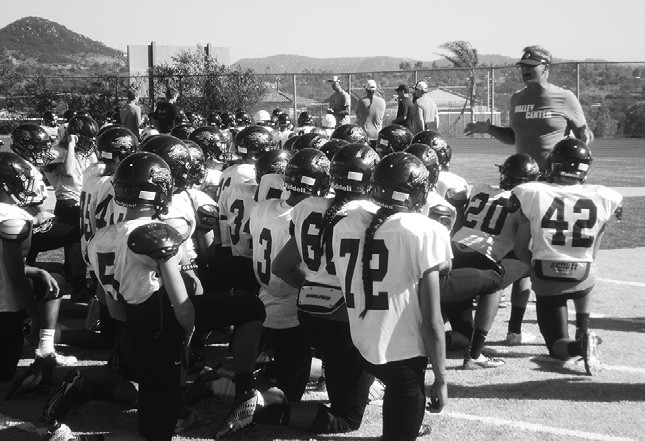 Coach Rob Gilster gives his team final instructions prior to the Jags' road trip to Brawley.