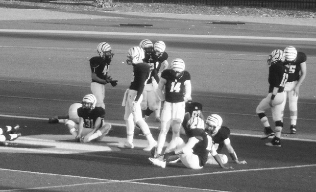 EC White Tigers unlimber before Friday's night's game with visiting Vincent Memorial.