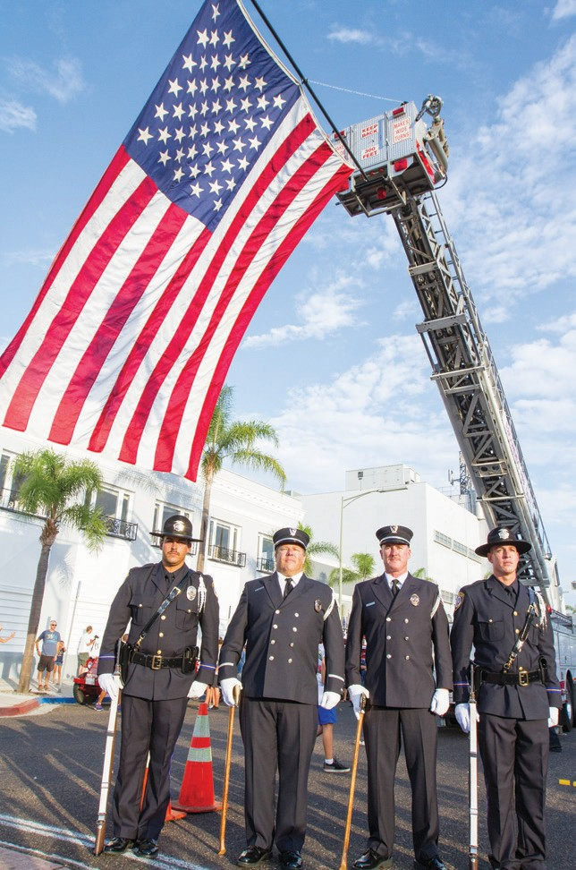 Escondido firefighters joined brother and sister firefighters all over the nation in remembering the nearly 3,000 dead on the 14th anniversary of 9/11, Patriot Day, which fell on one of the nights of Crusin' Grand. Photo courtesy of David Zumaya, DMZ Visual