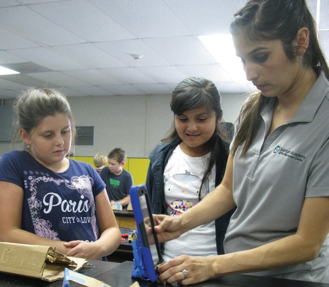 Above: Anna Distefano and Rita Sauceda work with Ms. Miramontes on their iPad mini projects. Photos by Doug Green.