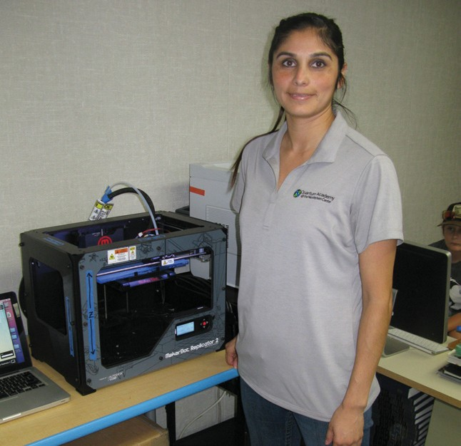 Below: Vanessa Miramontes had the academy's only 3-D printer running at top speed as her students prototyped, computer designed and prepared to create an iPad mini stand using the new 3-D printing technology.