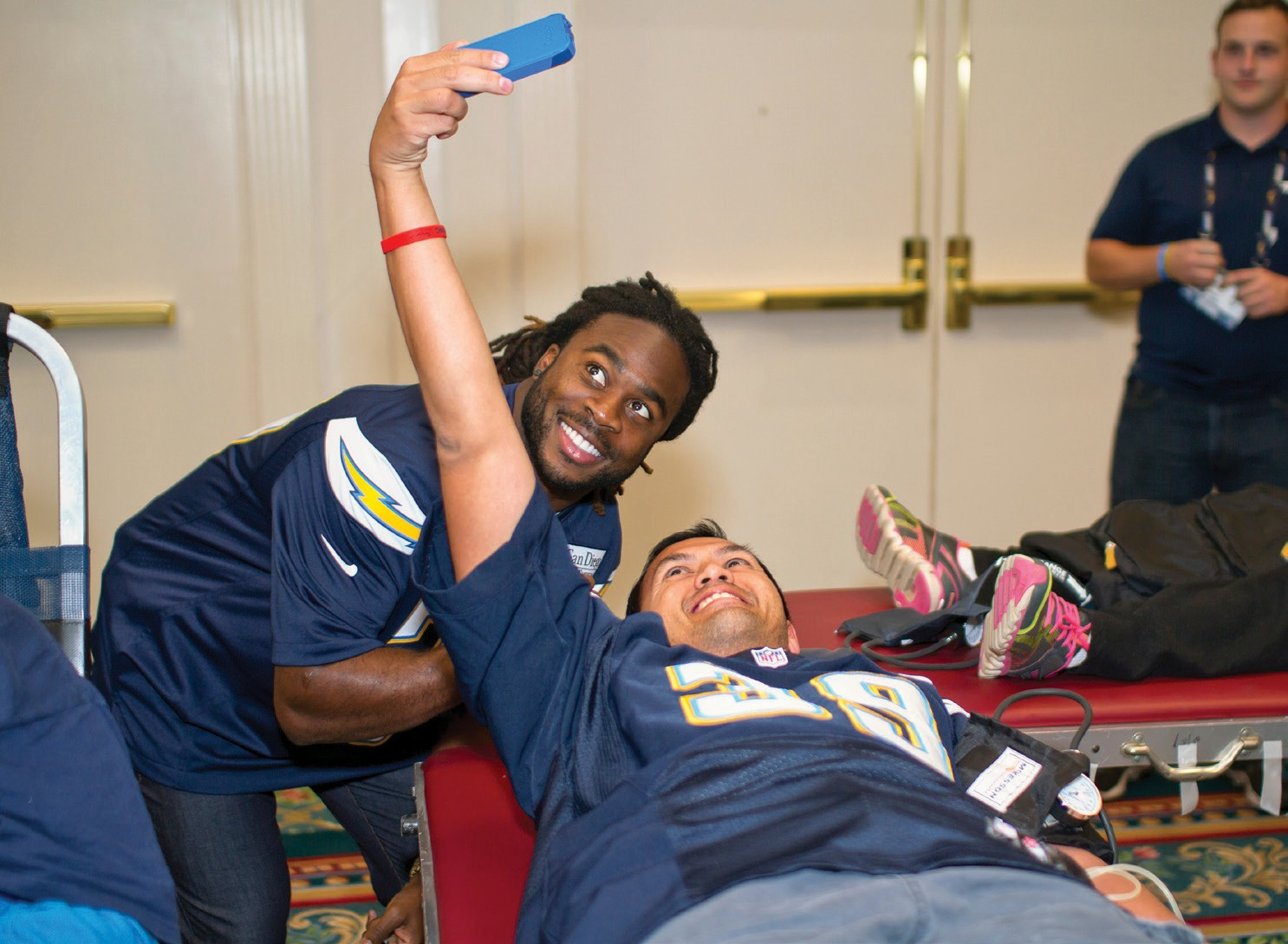 Chargers cornerback Jahleel Addae with blood donor at Chargers Drive