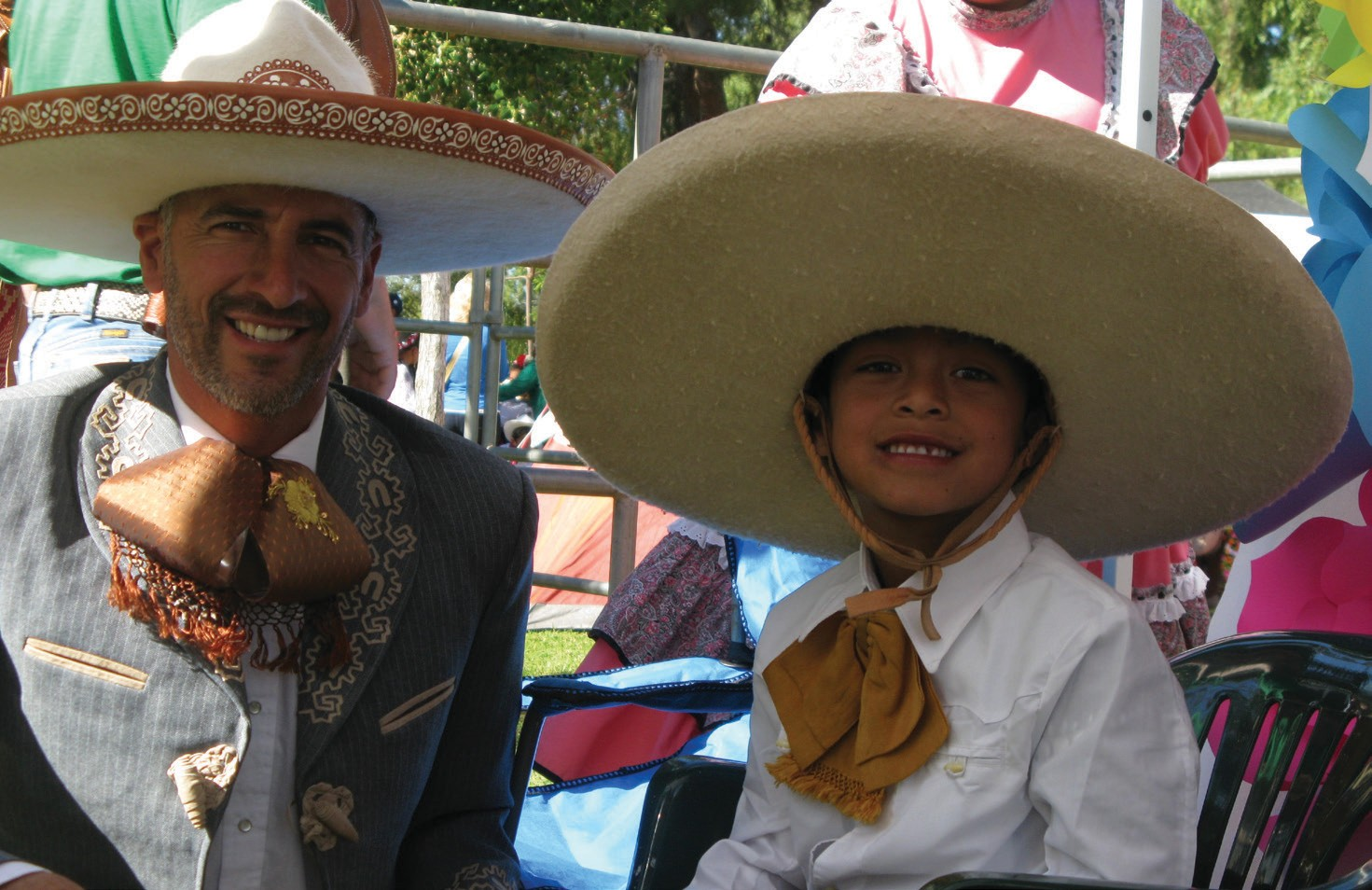 Dressed in authentic Mexican Charro duds, Jose Rodriguez, left, and Alexander Noyola wait for their performance with Herrencia Charra on the Grande Stage at last Saturday's event in Grape Day Park.