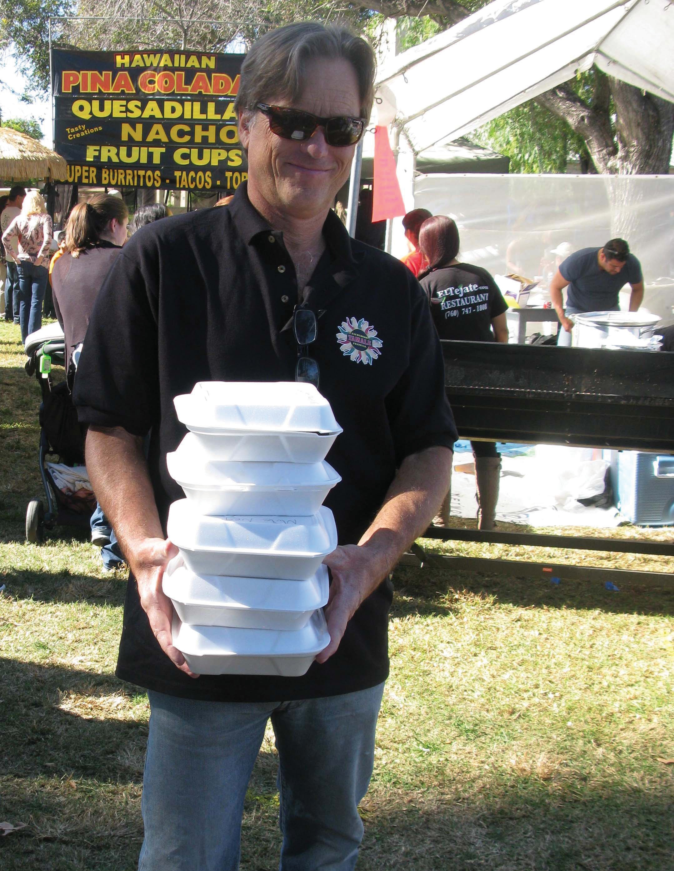 Guy MacLachlan stocks up on Mexican food at Saturday's First Annual Escondido Tamale Festival, which topped predictions of 5,000 visitors.