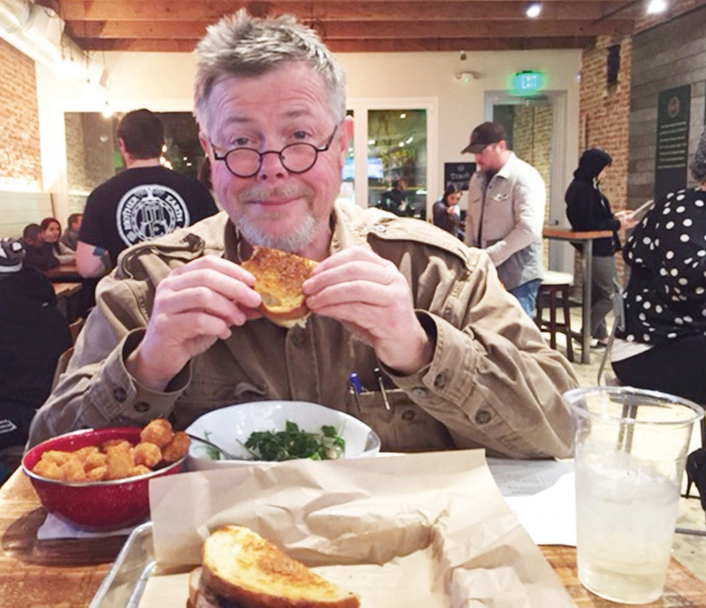 """The """"Belly Pulpit"""" (David Ross) enjoying a Brie and Fig Melt at the Burger Bench."""