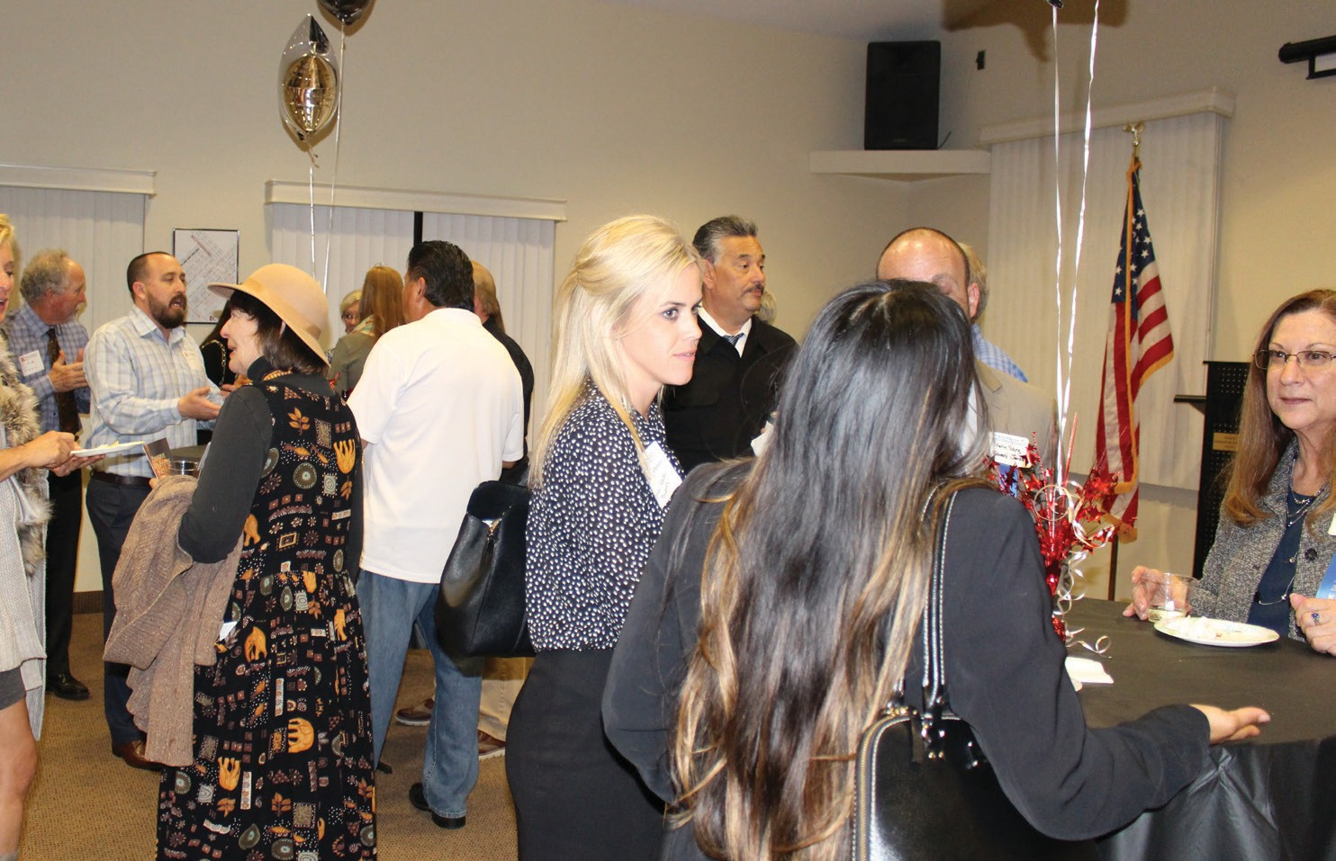Left to right: Lill Litschewski, CSSM/Board member (blond lady) speaking with Marie Schwab, Allbrand Toner (member).