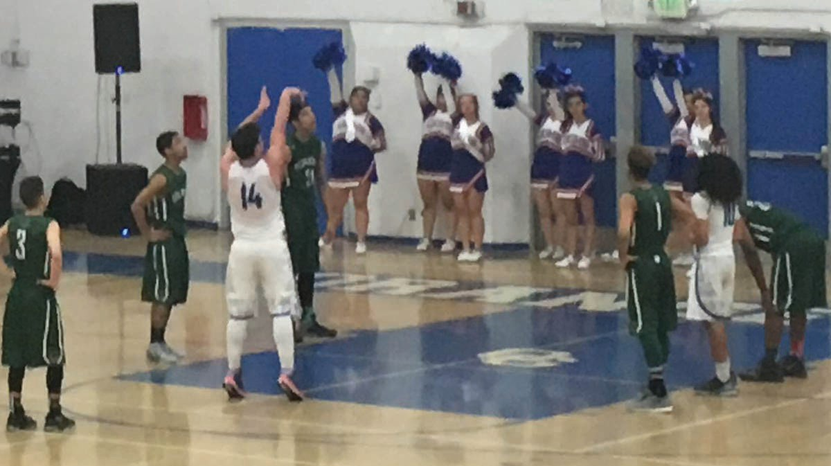 Nikola Kresovich (14), of San Pasqual High School, gives his free throw attempt plenty of arc.