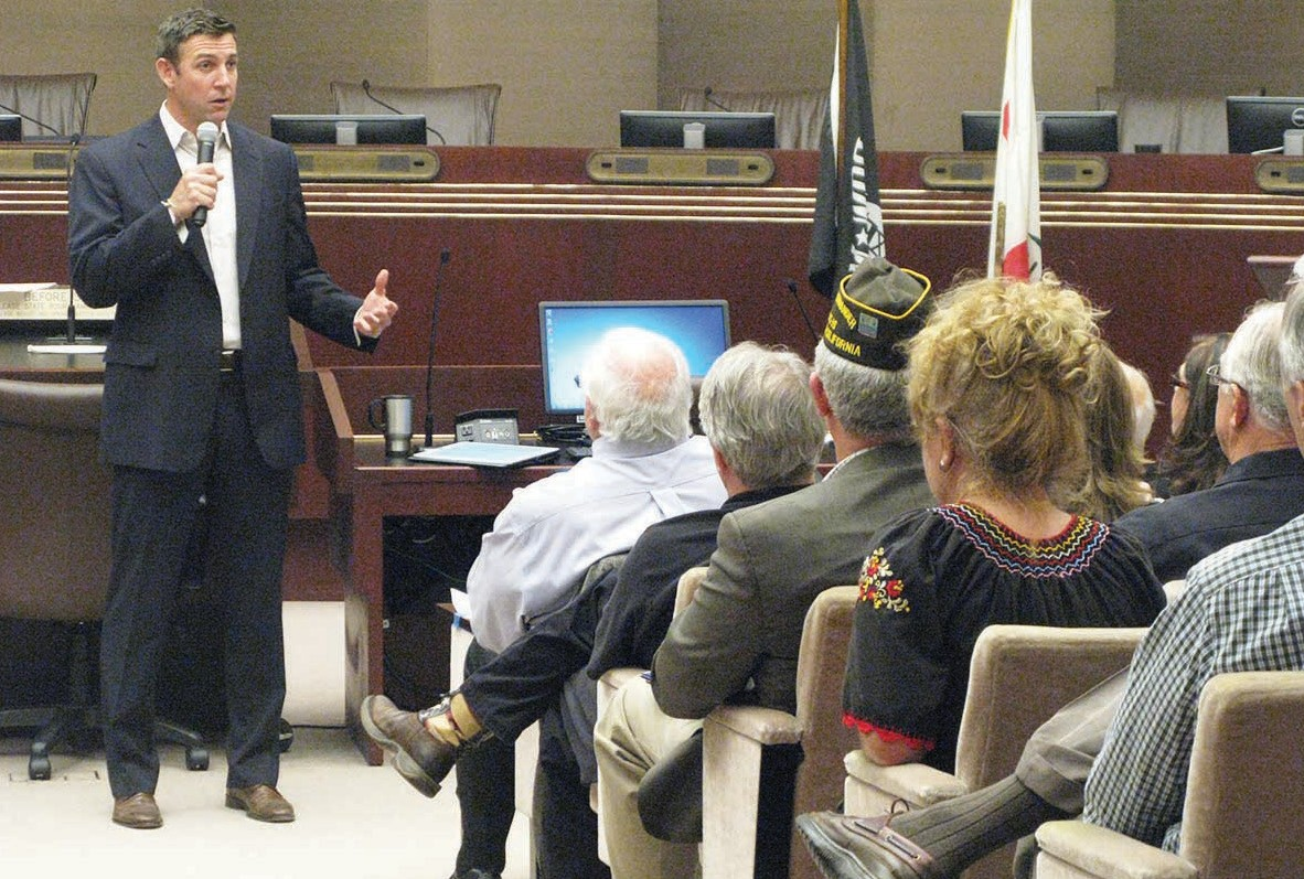 Congressman Duncan Hunter addressed more than 100 citizens and officials at a Town Hall meeting in Escon­dido's City Council Chambers.