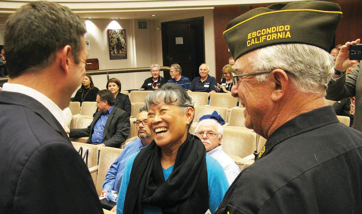 "Rep. Hunter chats with Veterans of Foreign Wars member Mike Burke and his wife Gina at the Town Hall meeting. The congressman spoke on a number of topics including his desire to ""blow up the VA"" to create bet­ter access to health care for veterans."