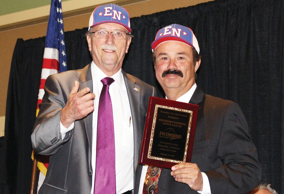 "Councilman Ed Gallo, left, praised Youth Award winner Wally Gutierrez, his Escondido National Little League and volunteers, saying ""Thanks to their hard work, Escondido now has some of the finest Little League facilities in San Diego County."""