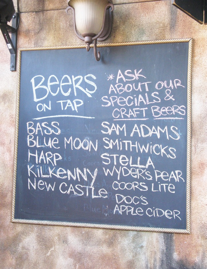 RIGHT: A sign lists the many varieties of beers at O'Sullivan's Pub and Restaurant in The Auld Black and Tan Patio in the rear of the establishment.
