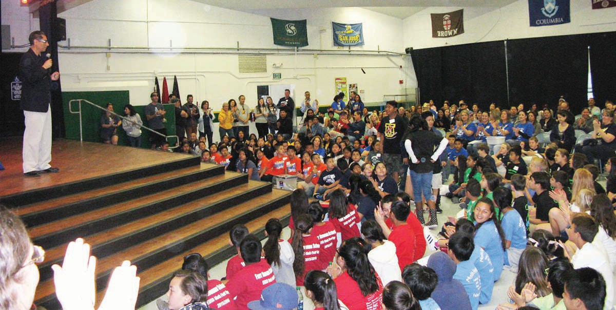 Superintendent Luis Rankins-Ibarra, at left, leads the award ceremony for the EUSD Math Field Day in Del Dios Academy's auditorium. A large number of parents, 160 competing students and dozens of EUSD staffers came together to further math education in the district.
