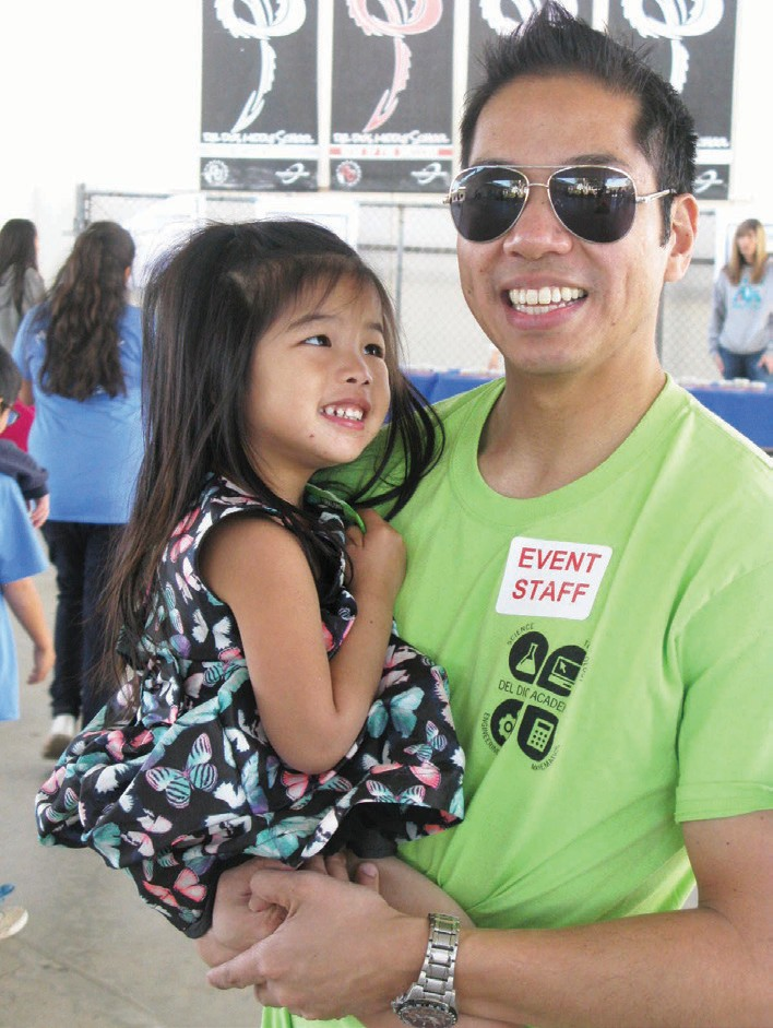 """Albert Ngo, principal of Del Dios Academy and his daughter Evelyn attended the Math Field Day and discussed the innovative teaching methods at the Academy. Ngo said the district's """"specialty school"""" houses Visual and Performing Arts (VAPA) and Science, Technology Engineering and Math (STEM) modules."""