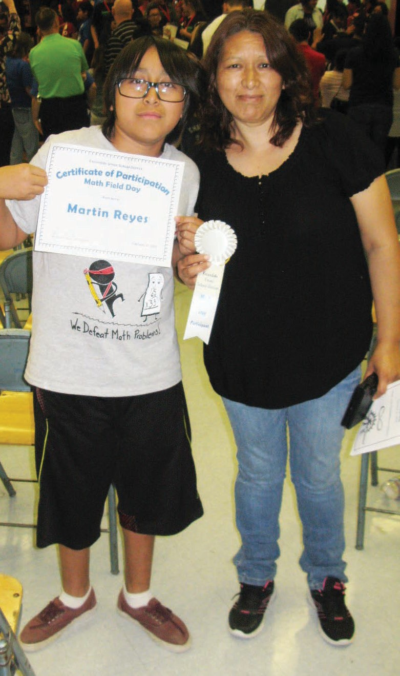 Martin Reyes and his mom, Elia Garcia, were on hand to win a certificate for performance of math problems.