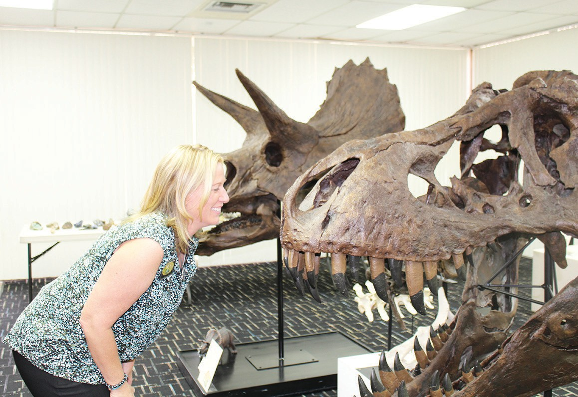 Sherry Bauer, director of education and special events, gets a little face time with a T-Rex.