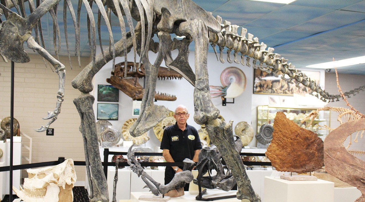 Keith Roynon framed by the fossilized remains of one of the giants of dinosaur age.
