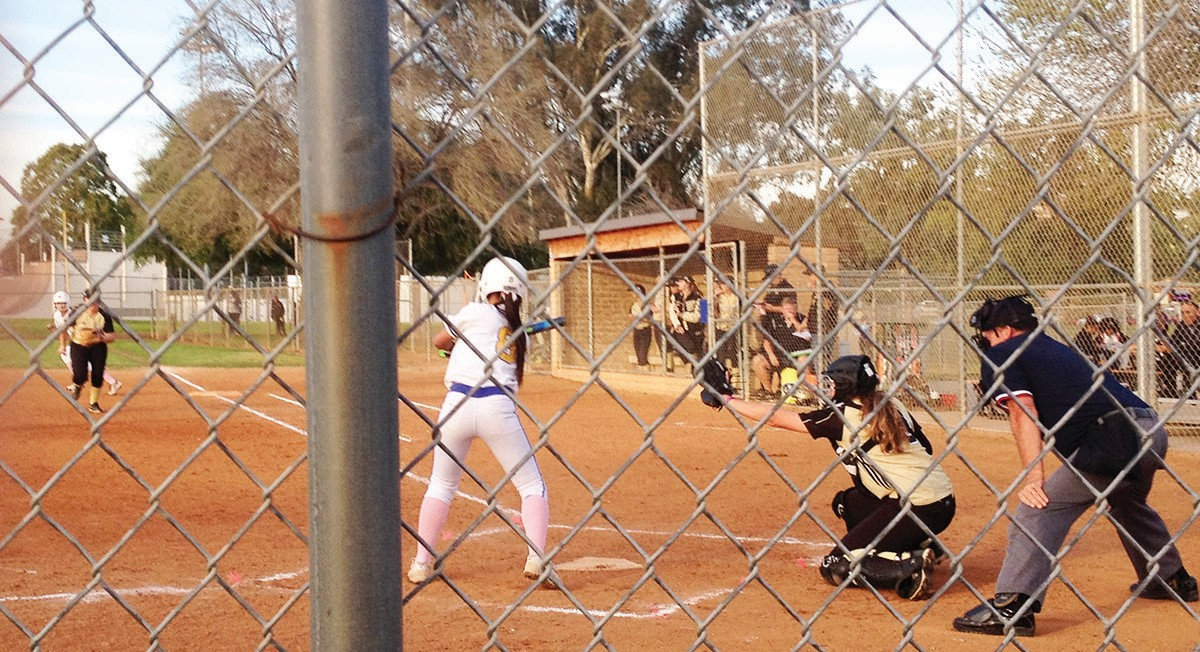 A San Pasqual batter squares around for a bunt attempt.