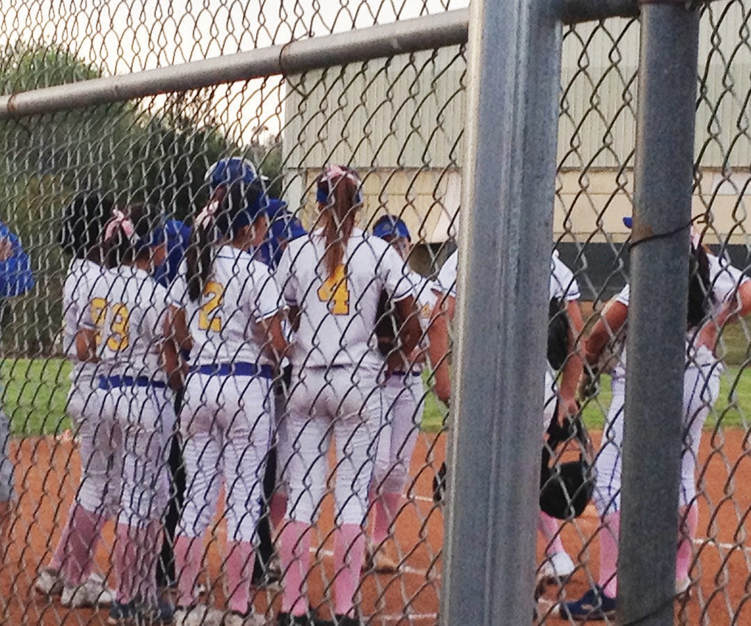 The Golden Eagles have a confab during the game versus Westview.