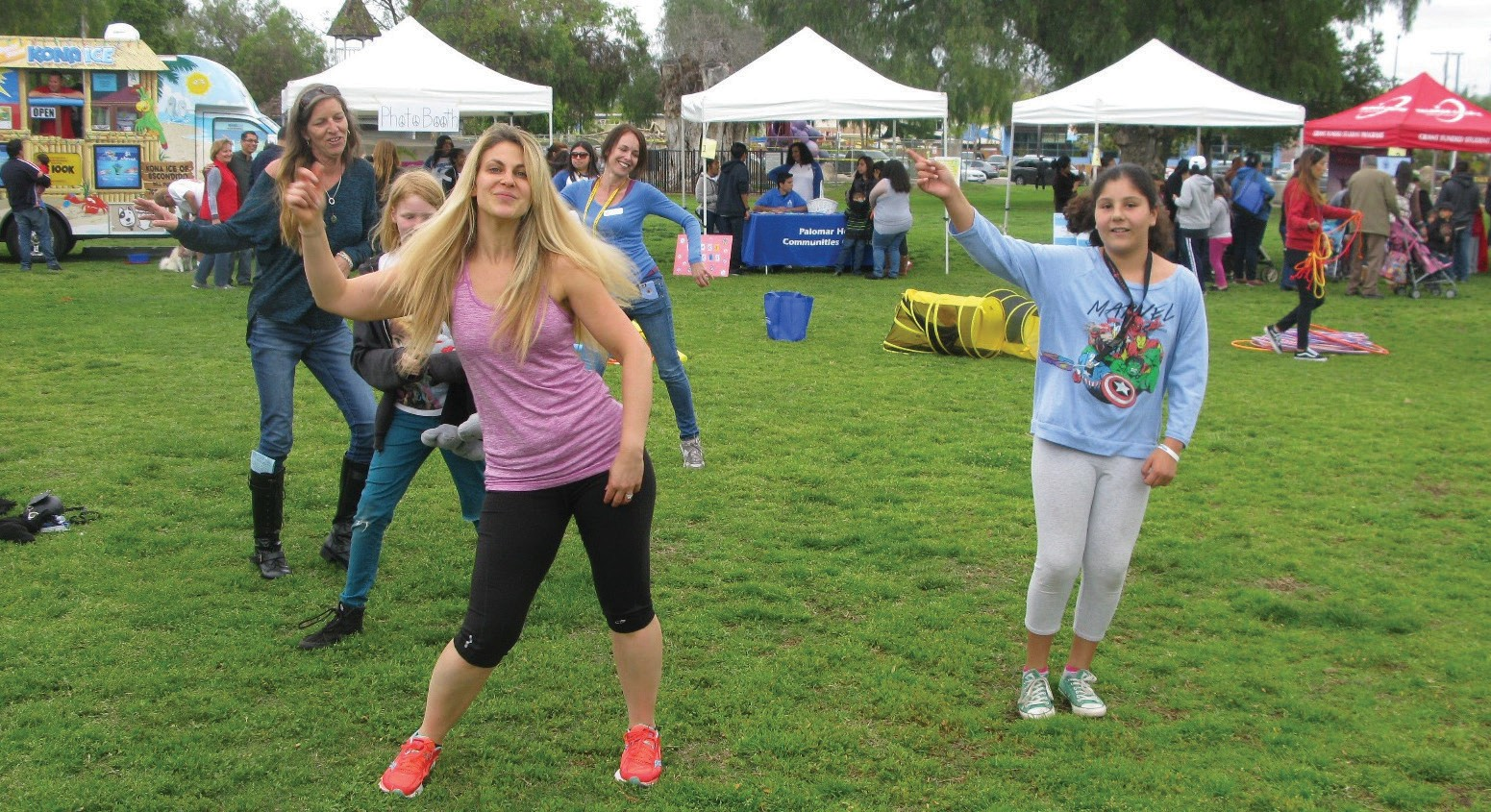Jamie Cassutt-Sanchez leads Kimberly Israel, EUSD's outreach coordinator (behind, left) and all comers in Kids Yoga at the school district's Peace Begins with ME event last Saturday in Grape Day Park.