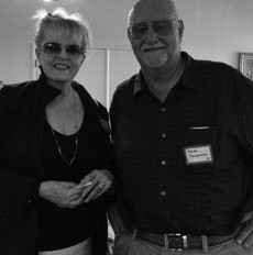Reunion host Roger Tischendorf welcomed Sherry Samarzea who drove to the reunion from Bend, Oregon.