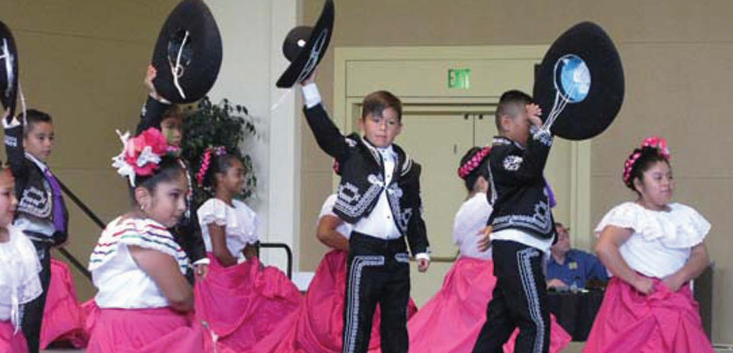 Performing artists such as these charros and fancy dancers of the Ballet Folklorico de Farr School perform traditional Mexican dances at the smART Fest at California Center for the Arts.