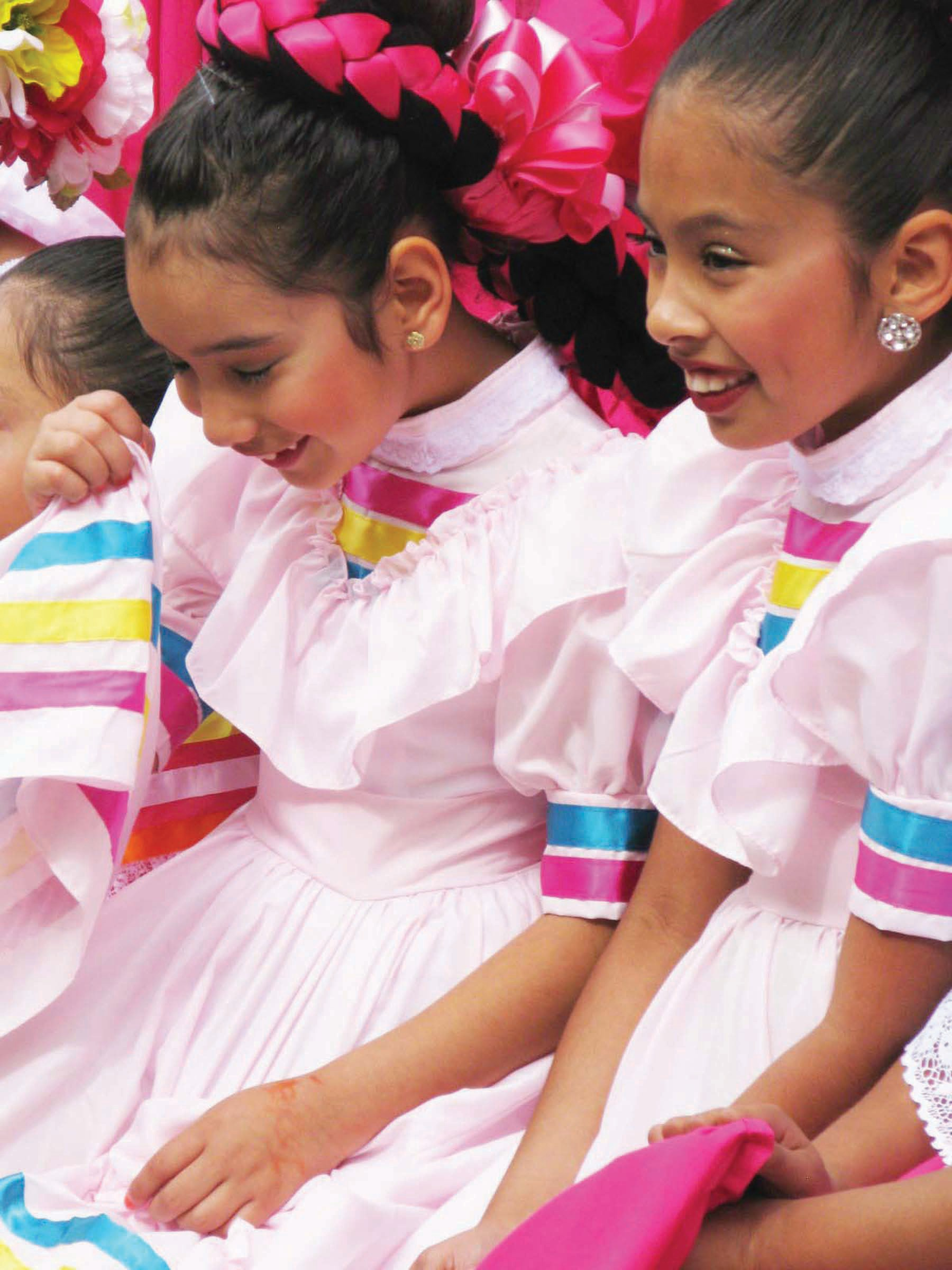Members of the Ballet Folklorico de Farr School, congregate offstage at the California Center for the Arts.