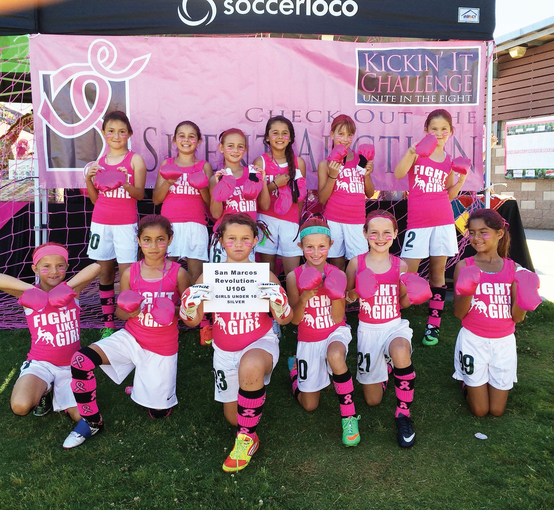 Young soccer players wear pink to show their support for battling breast cancer.